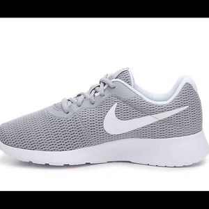 Women's Nike Tanjun Sneakers in Grey